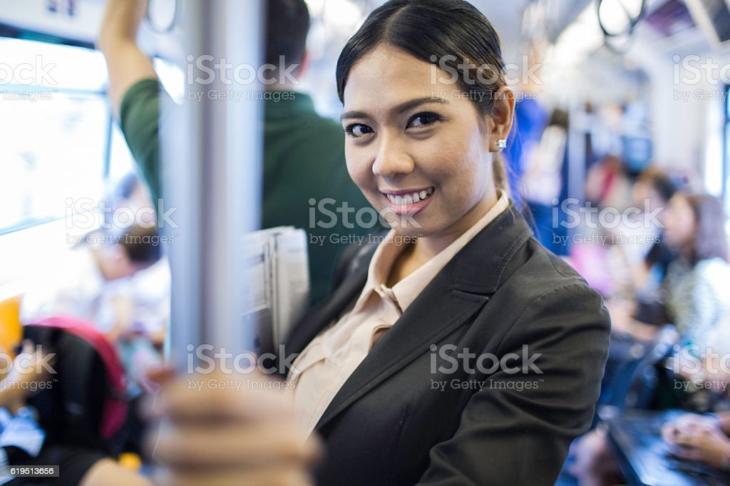 Business woman riding the elevated train in Bangkok. stock photo