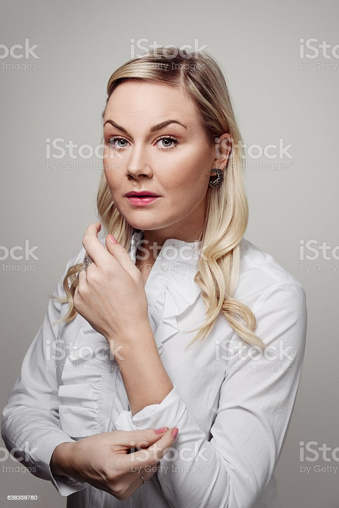 Business woman rolling up her sleeves stock photo