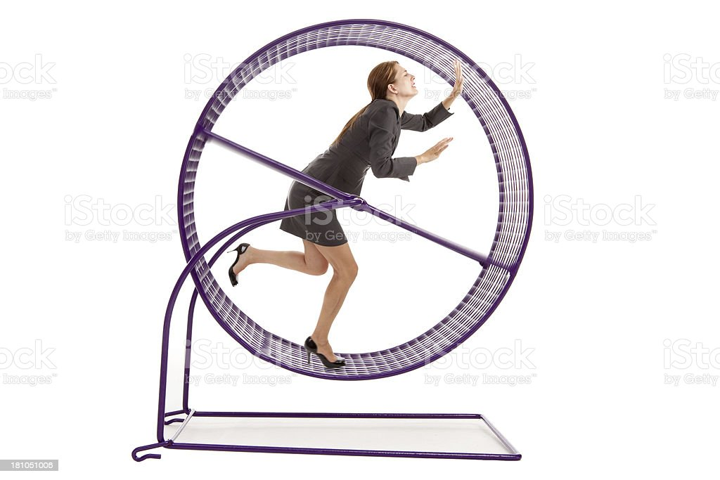 Business Woman Running on a Hampster Wheel stock photo