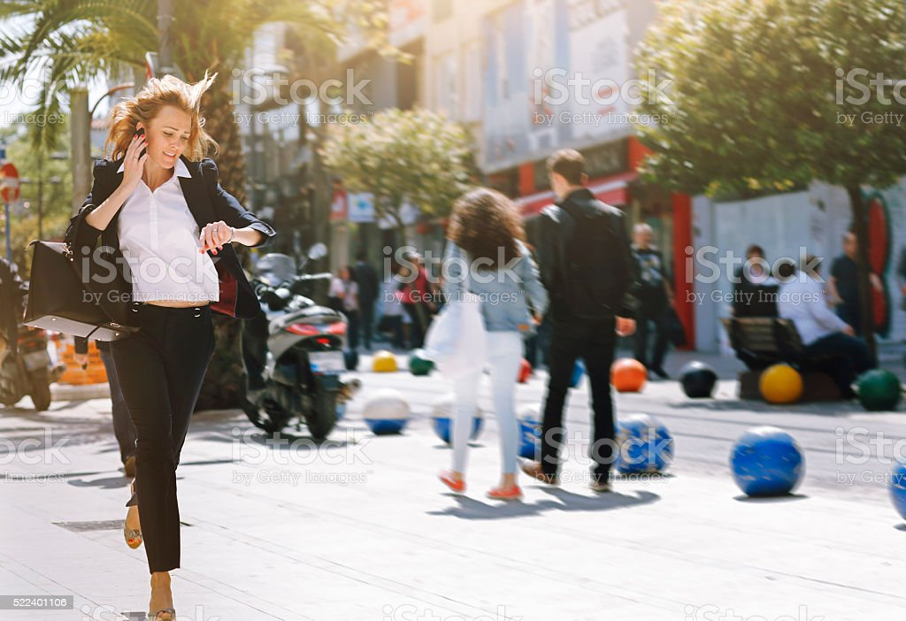 Business woman rushing to work stock photo