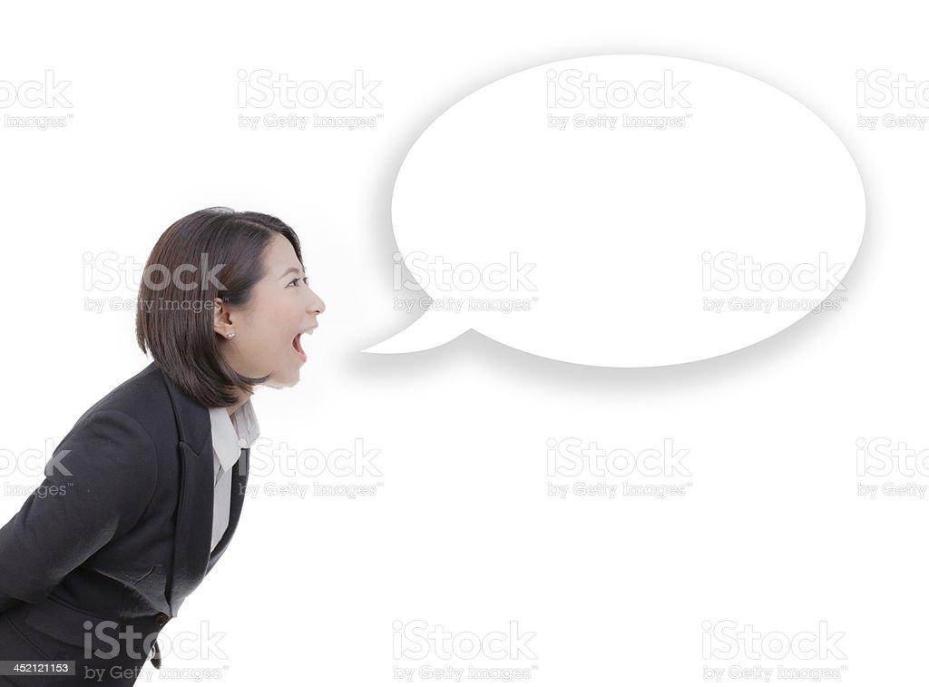 business woman screaming in blank speech bubble stock photo