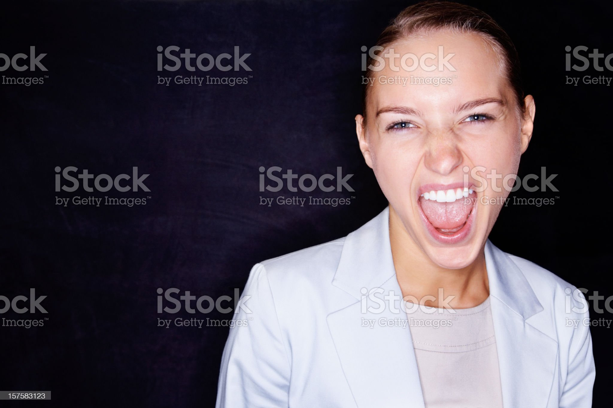 Business woman screaming on black background royalty-free stock photo