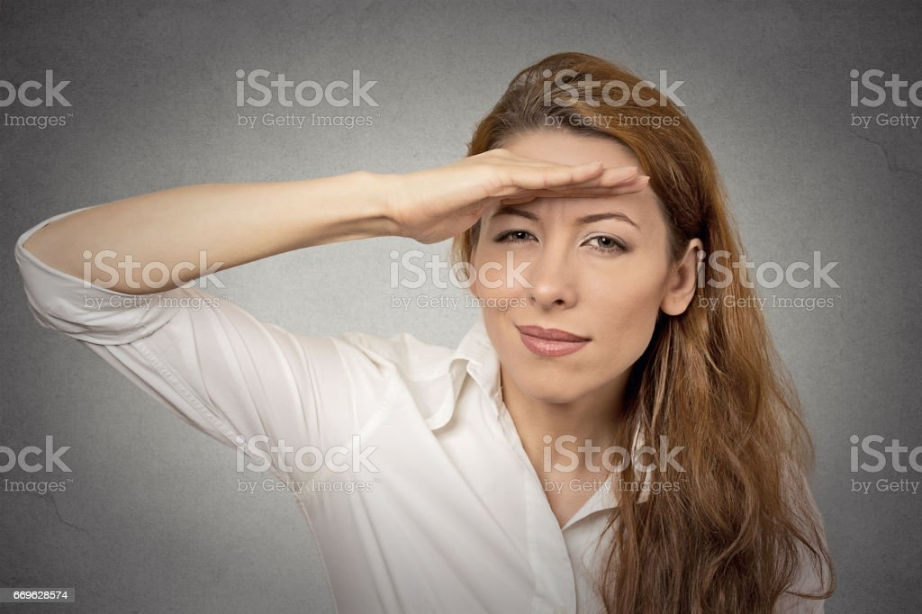Business woman searching looking far away into future monitoring stock photo