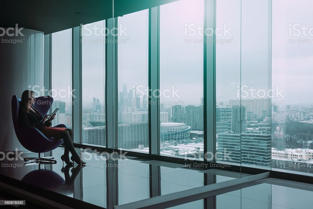 Business woman seated on a chair stock photo