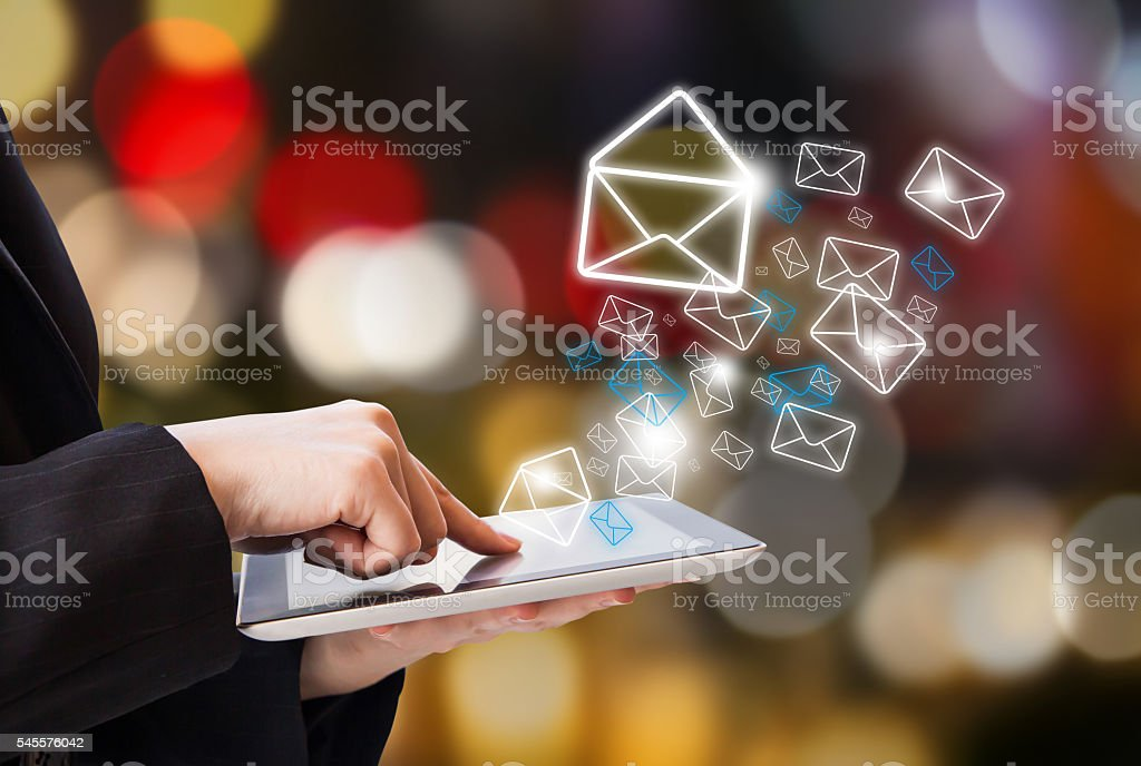 Business woman sending email stock photo