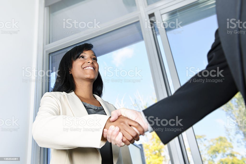Business woman shaking hands royalty-free stock photo