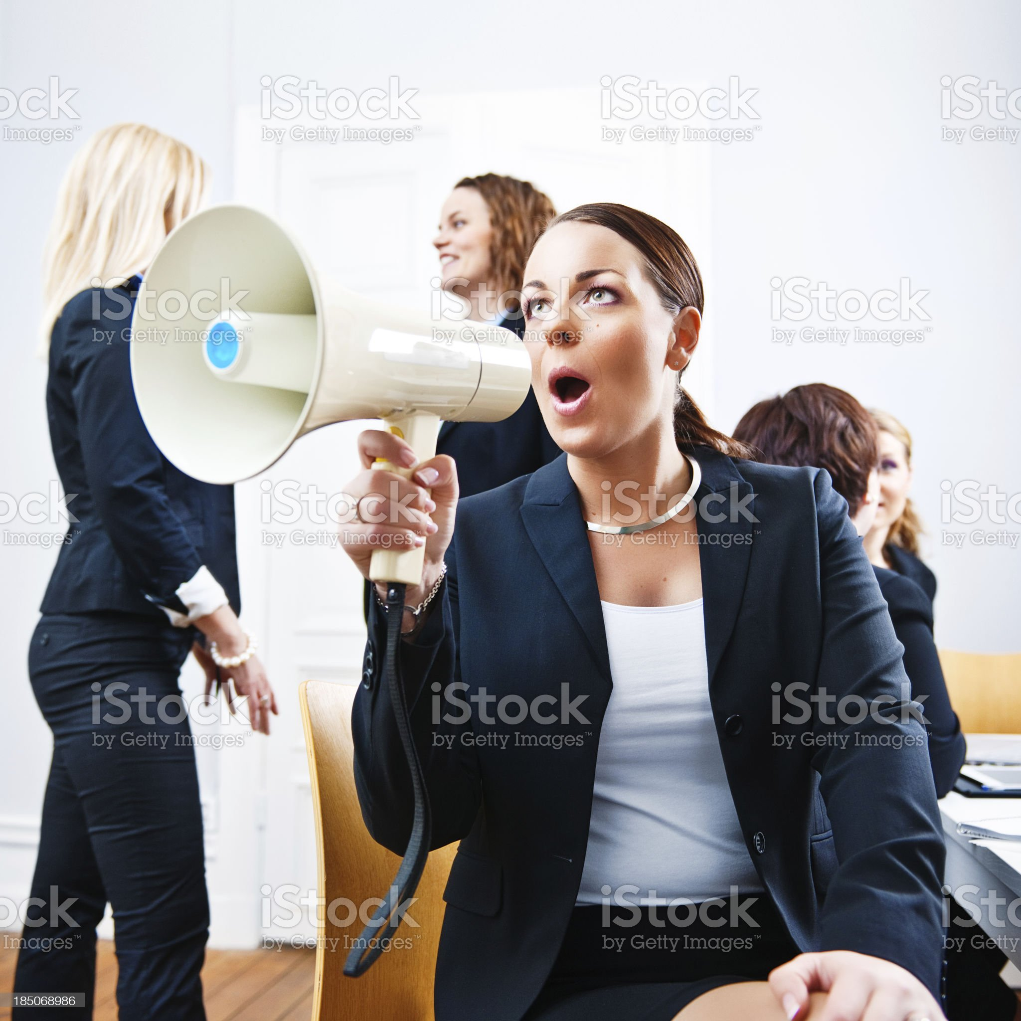 Business woman shouting in a megaphone royalty-free stock photo