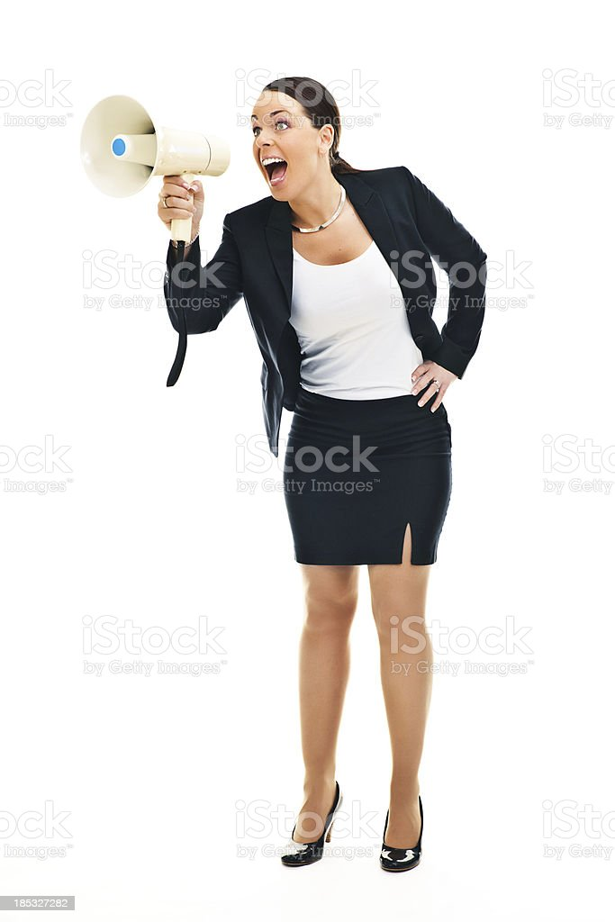 Business woman shouting in a megaphone stock photo
