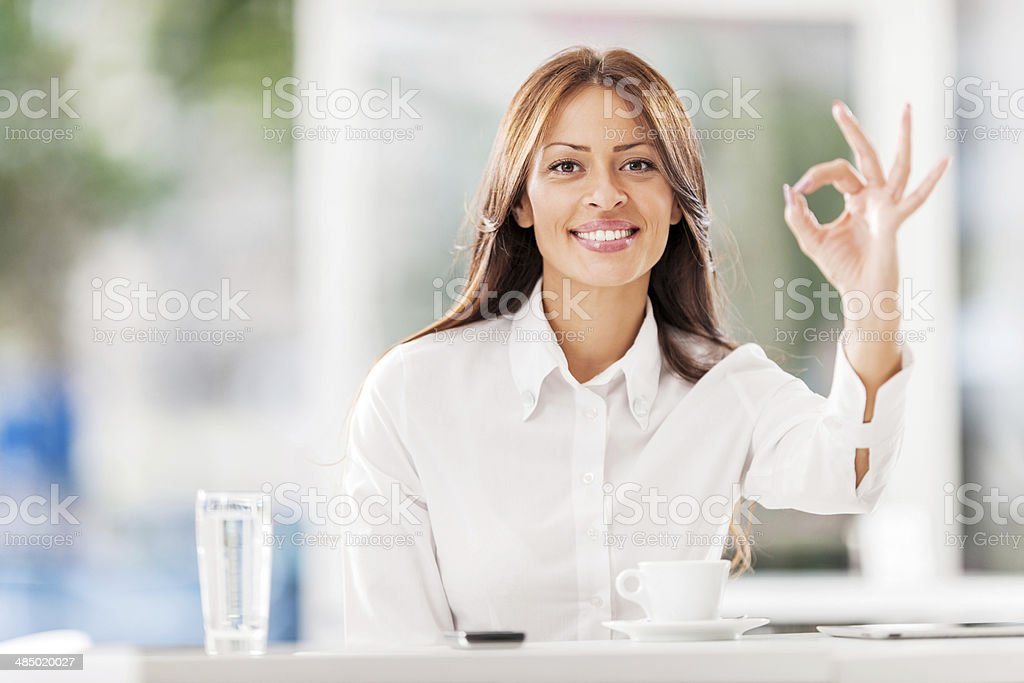 Business woman showing ok sign. royalty-free stock photo