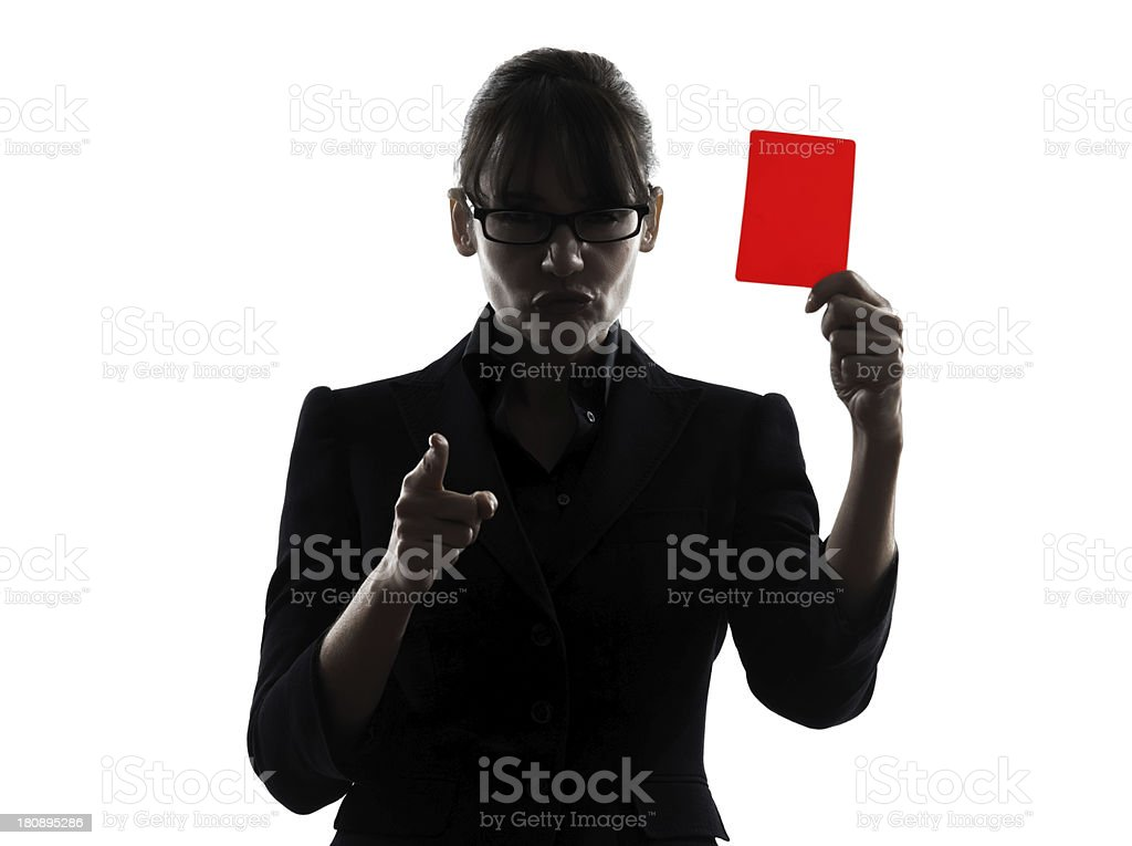 business woman showing red card silhouette stock photo