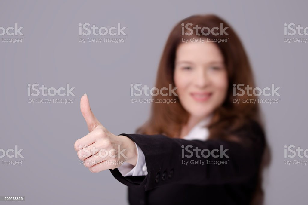 business woman showing thumbs up. stock photo