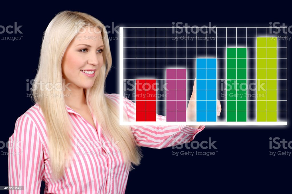 Business woman shows a graphic curve stock photo