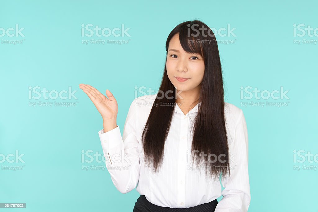 Business woman shows the way stock photo