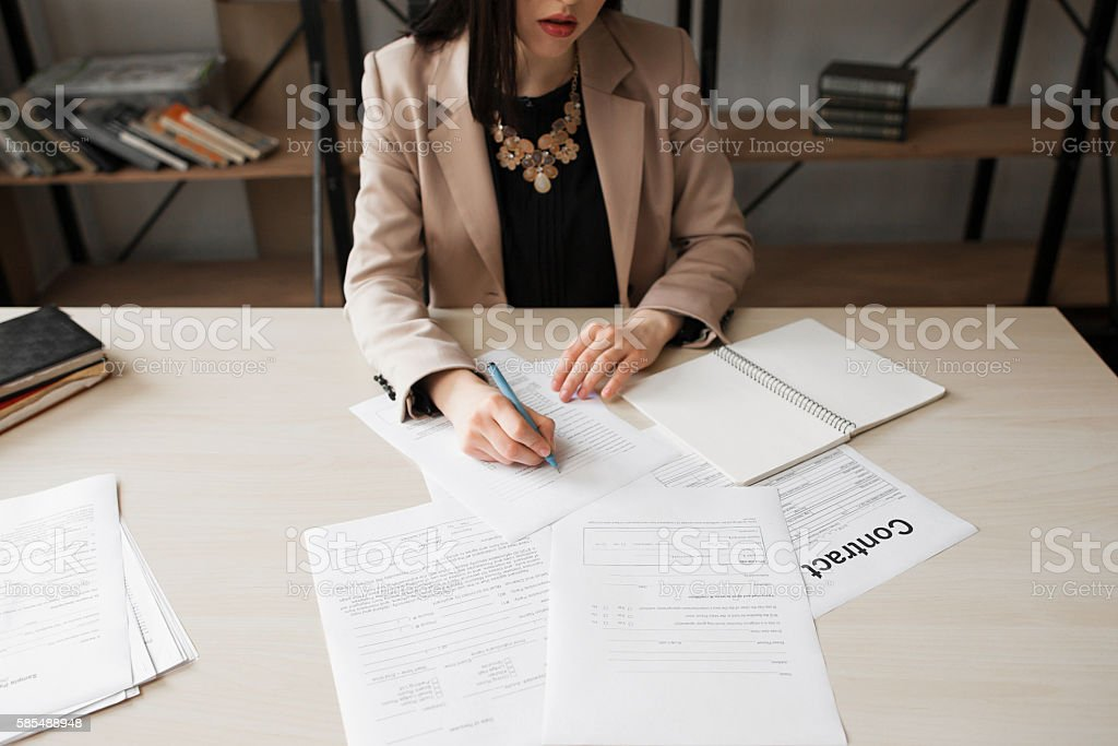 Business woman signing contract, success stock photo