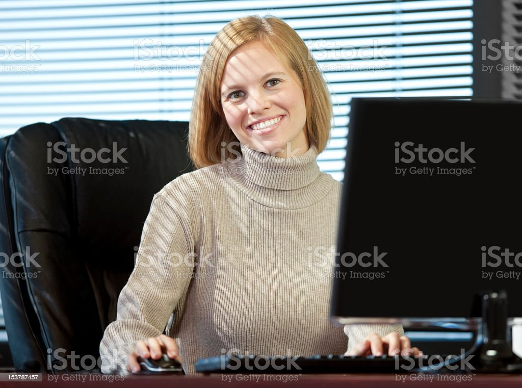 Business Woman Sitting At Desk In The Office royalty-free stock photo