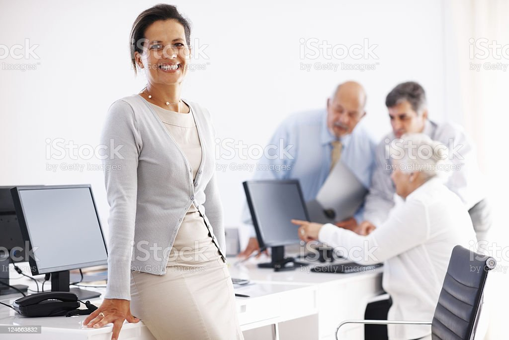 Business woman sitting at her desk royalty-free stock photo