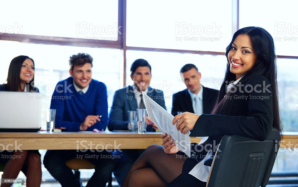 Business woman sitting at interview stock photo