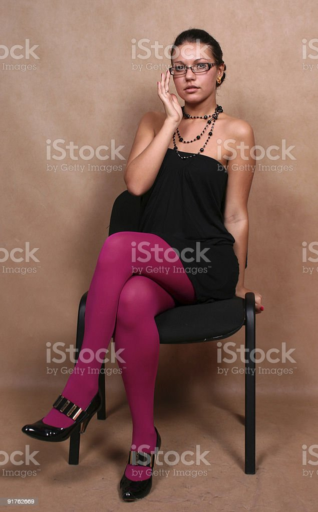 Business woman sitting on a chair royalty-free stock photo