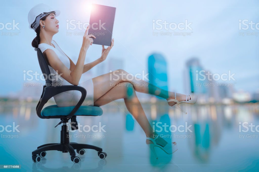 Business woman sitting on chair stock photo