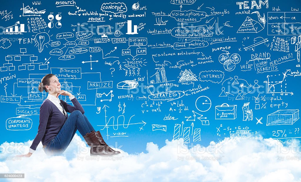 business woman sitting on the clouds stock photo
