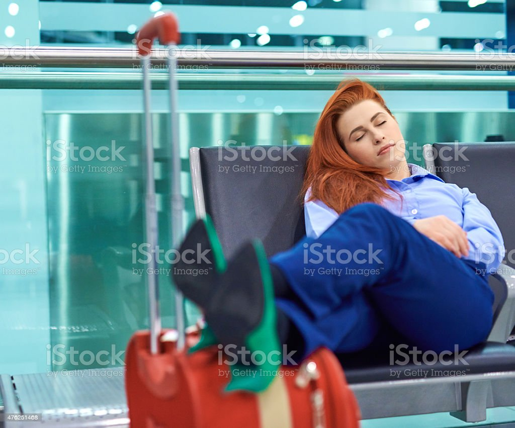 business woman sleeping in airport stock photo