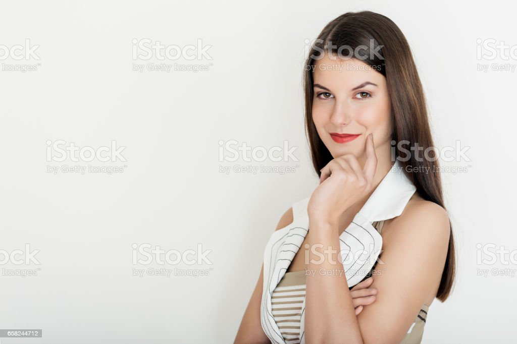 Business woman smiling, waist up portrait against white background stock photo