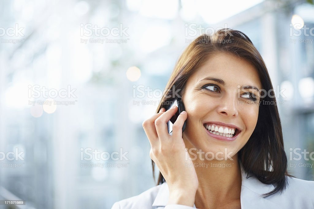 Business woman smiling while talking on the phone royalty-free stock photo