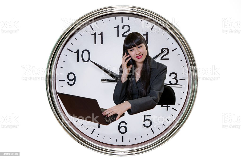 Business woman smiling with laptop and big clock background stock photo