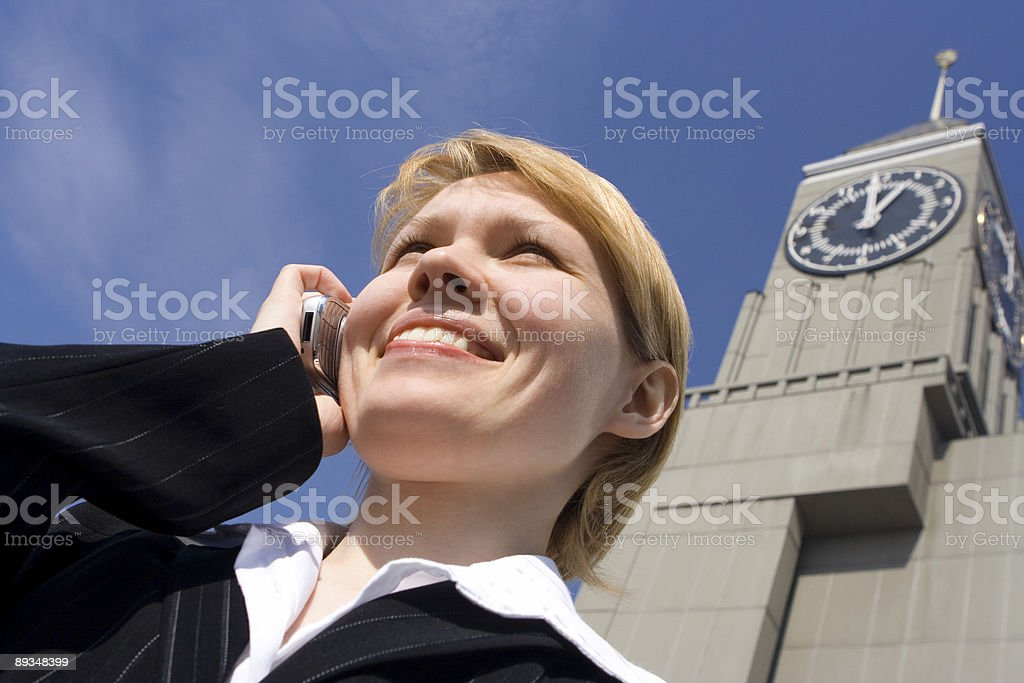 business woman speaks by phone stock photo
