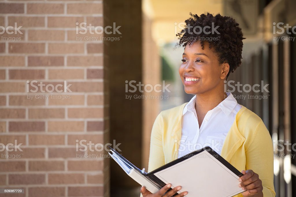 Business woman standing outside an office building. stock photo