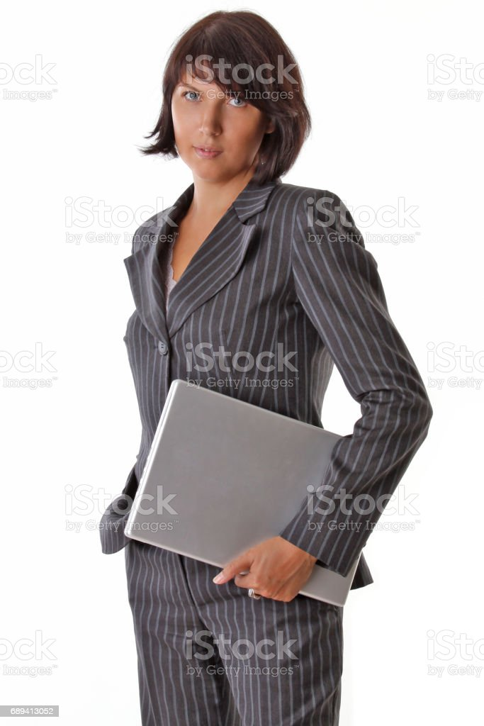 business woman standing with laptop stock photo