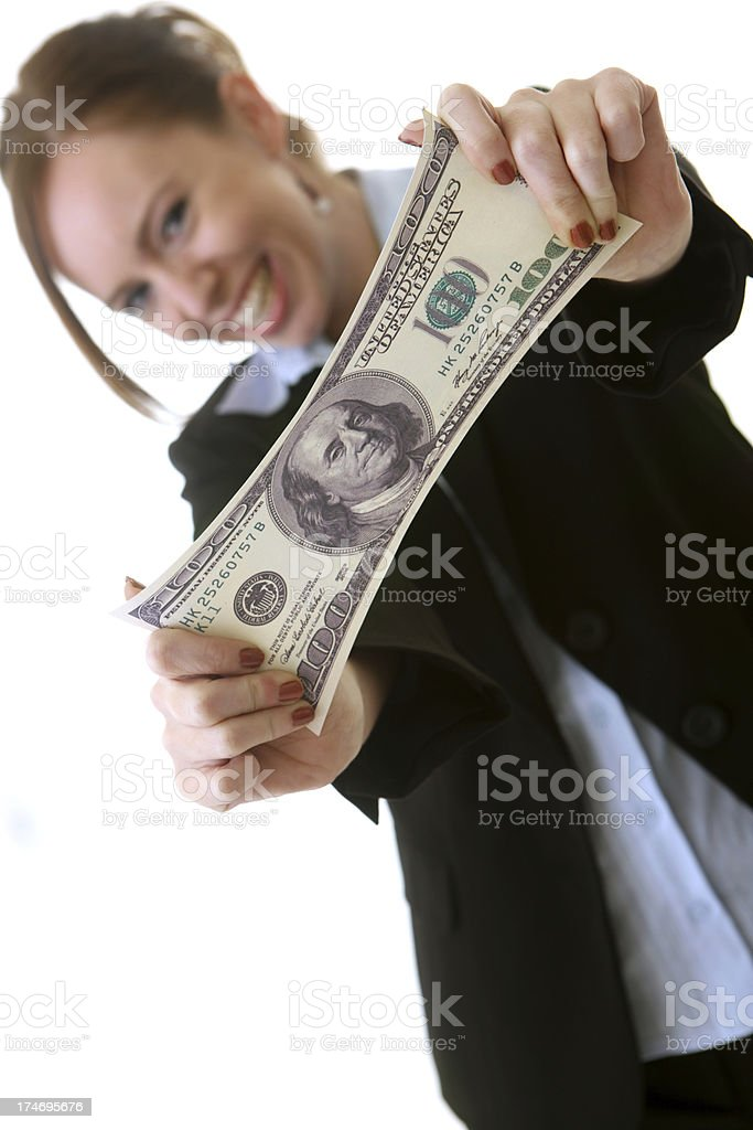 Business woman stretching a US note royalty-free stock photo
