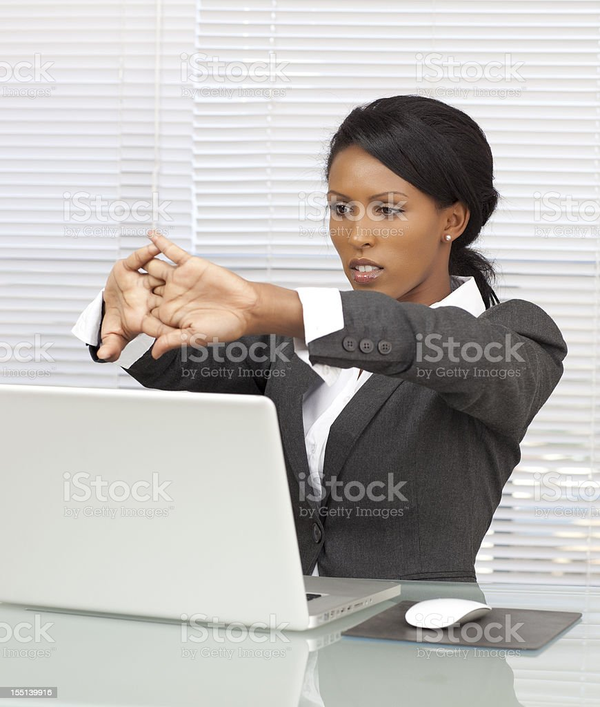 Business Woman stretching at work. royalty-free stock photo