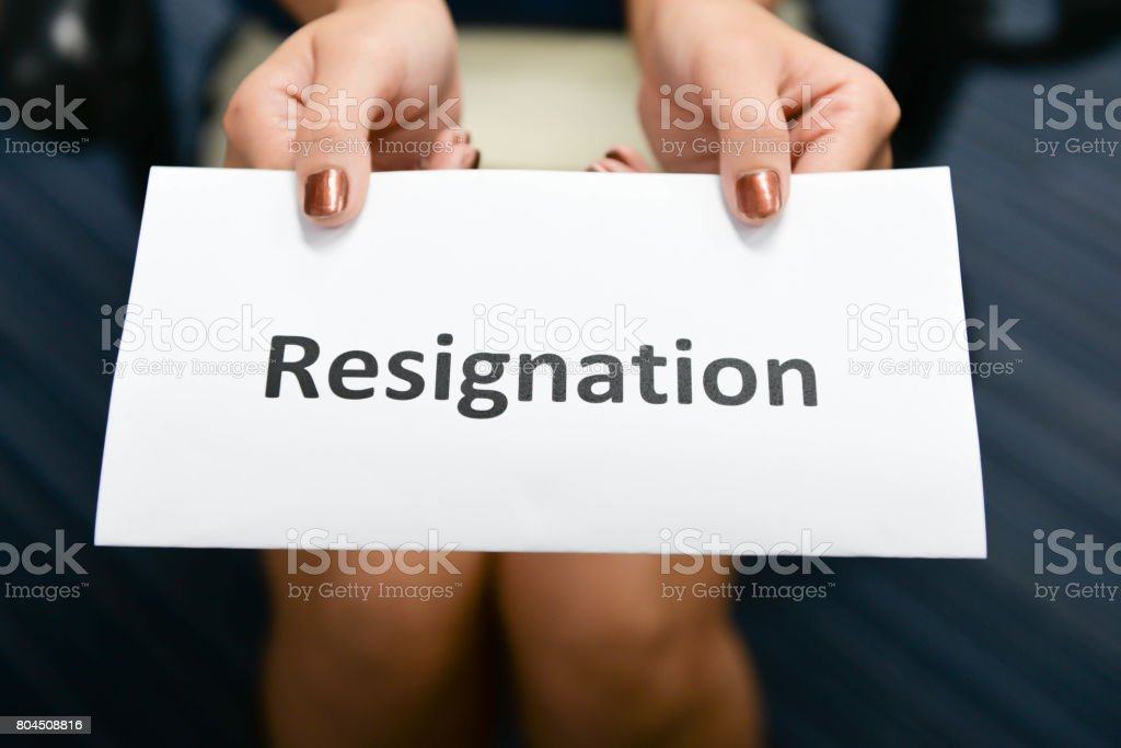 Business woman submitted the Letter of Resignation stock photo