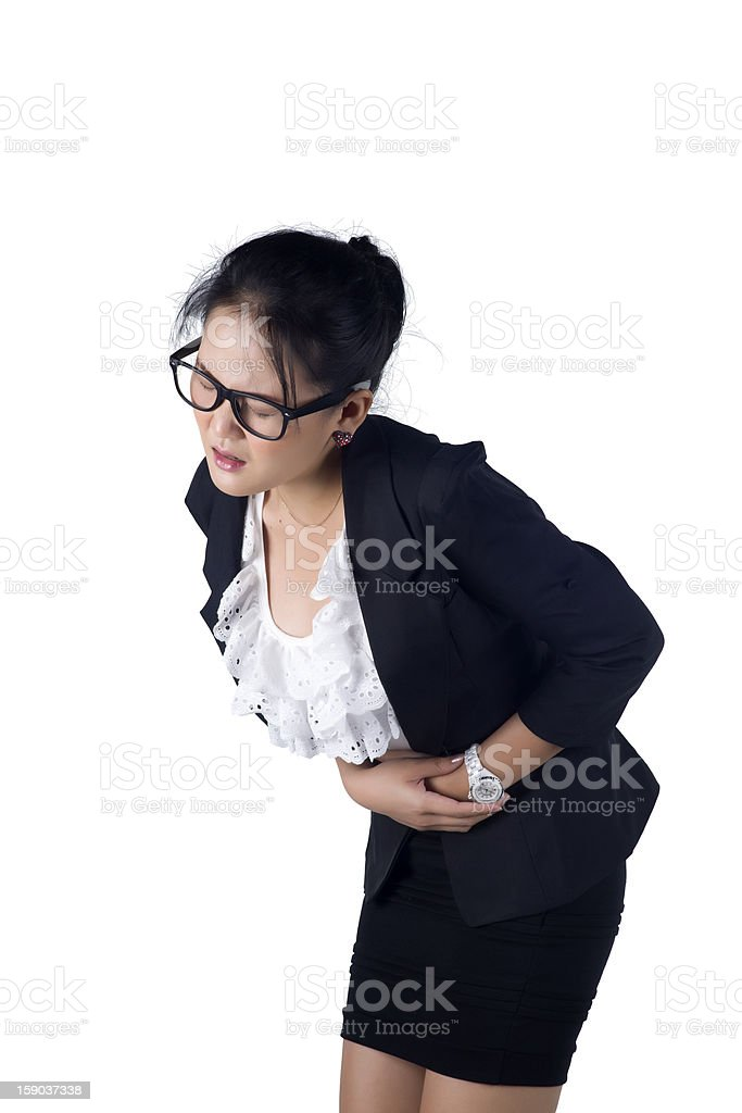 Business woman suffers from stomachache royalty-free stock photo