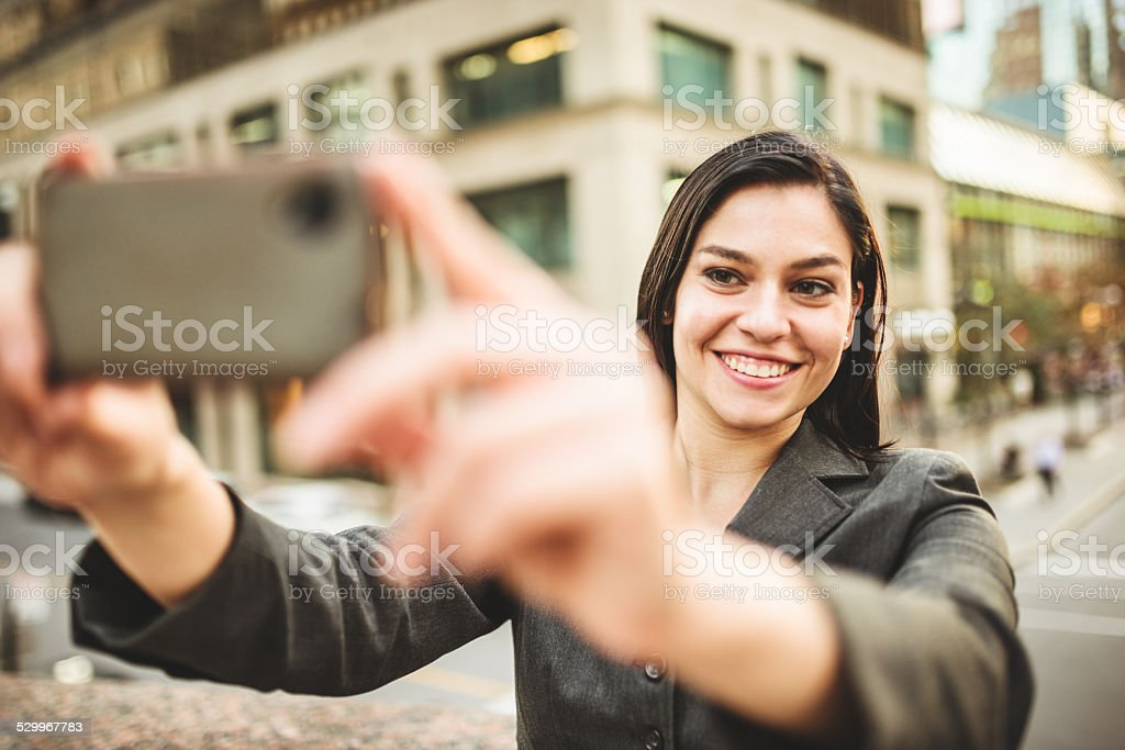 business woman take a selfie on the city stock photo