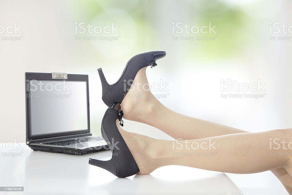 woman resting with feet taking off shoes pictures, images and