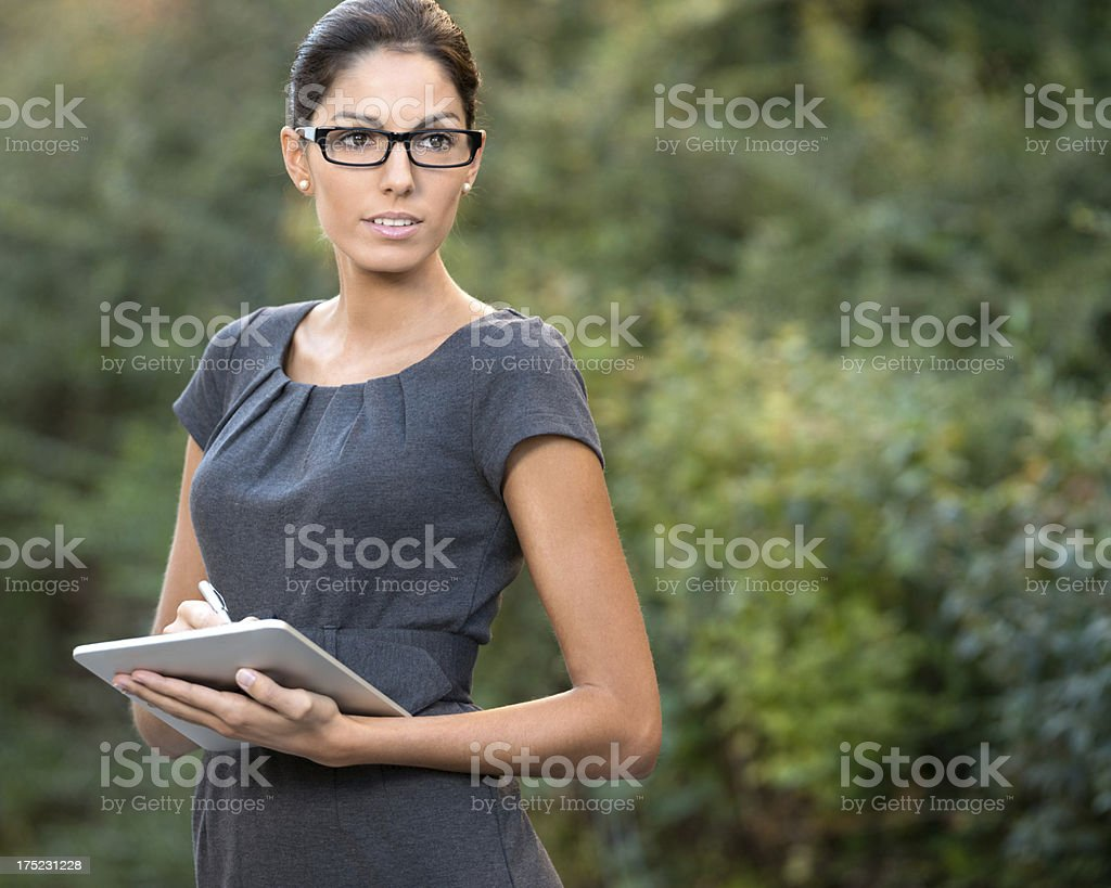 Business Woman taking Notes on a Digital Tablet stock photo