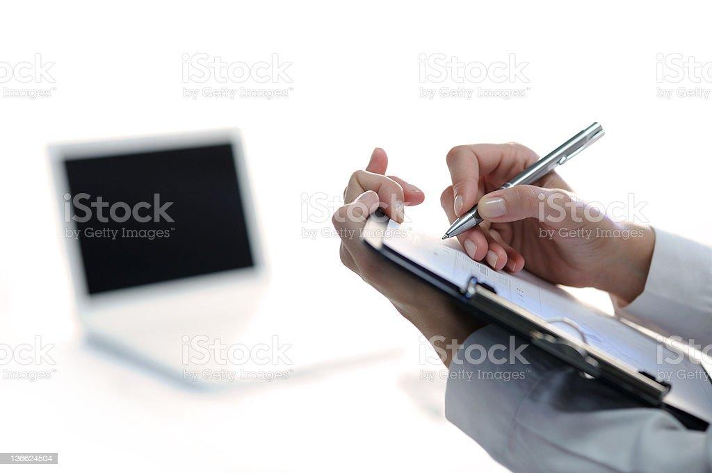 Femme d'affaires prise de notes photo libre de droits