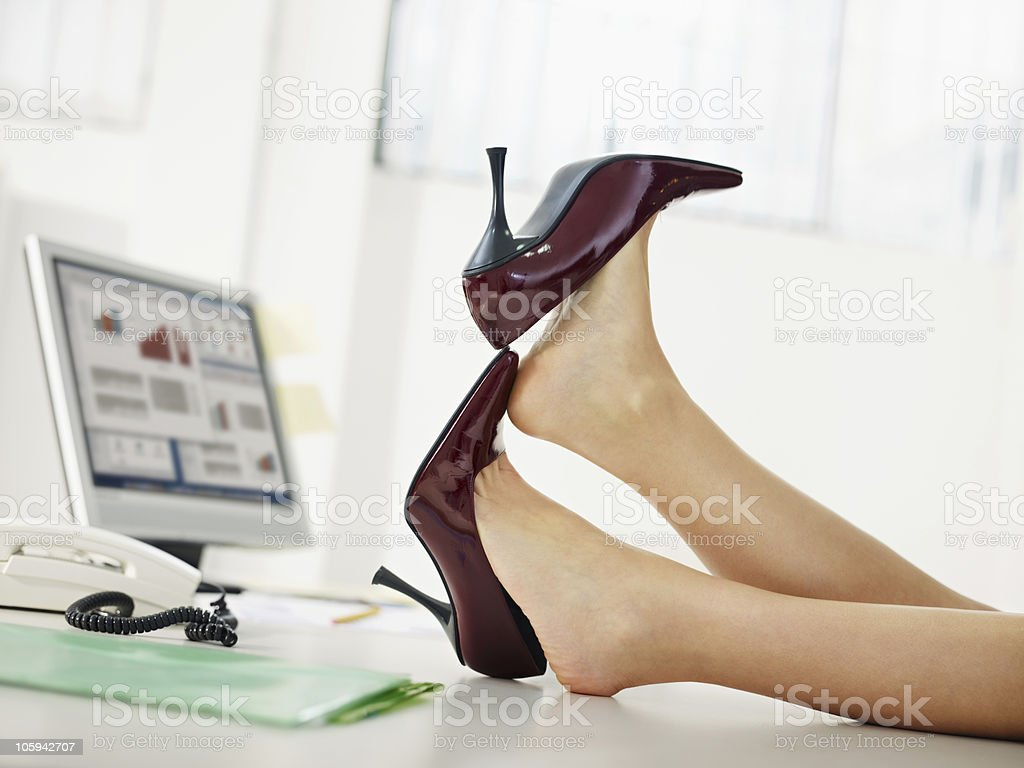 business woman taking off shoes royalty-free stock photo