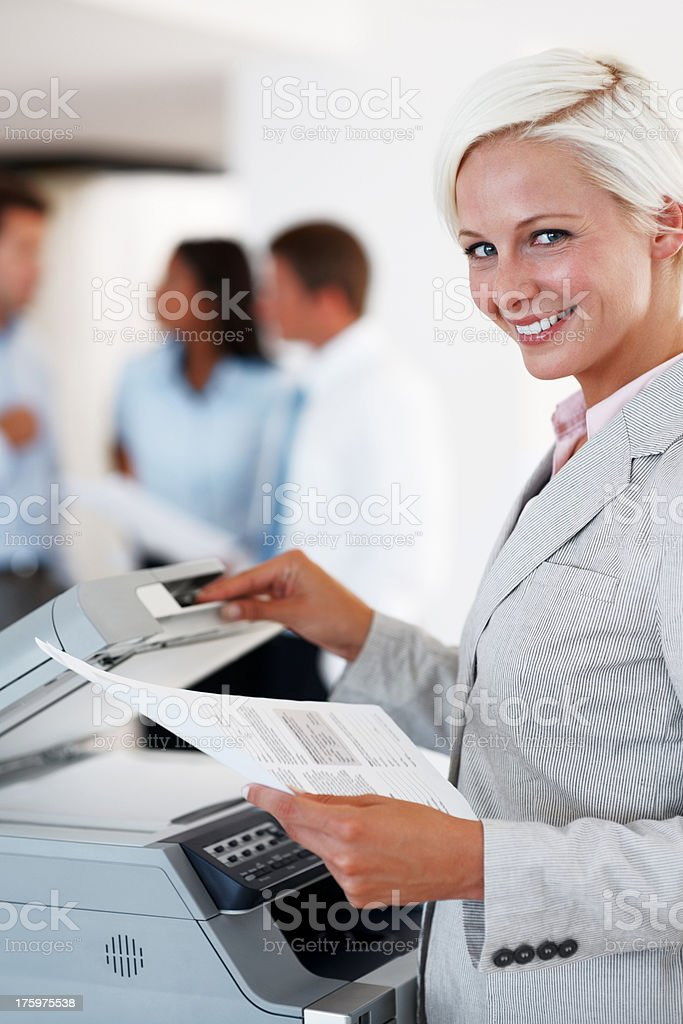 Business woman taking out a Xerox copy stock photo