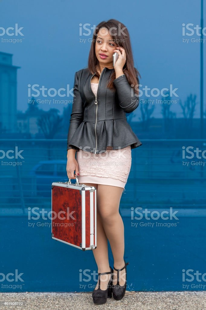 business woman talking on mobile smart phone outside stock photo