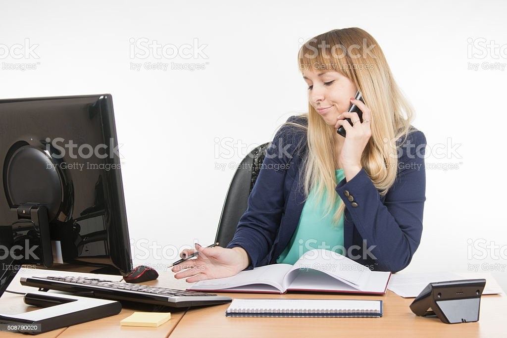 Business woman talking on phone and understands that planned meeting stock photo