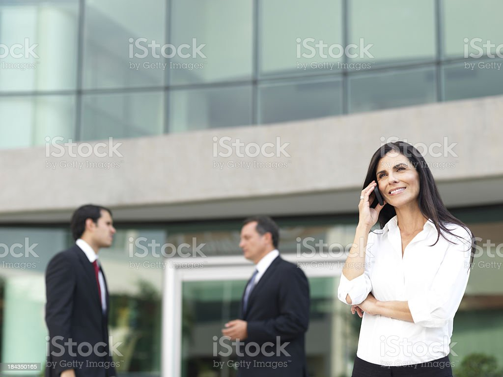 Business woman talking on the phone in her break royalty-free stock photo