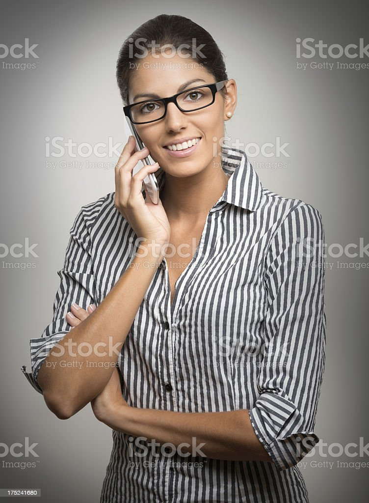 Business Woman talking on the Smart Phone stock photo
