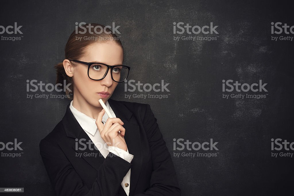 business woman teacher  glasses and a suit with chalk royalty-free stock photo
