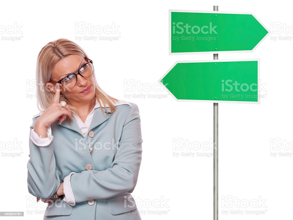 Business woman thinking about direction stock photo