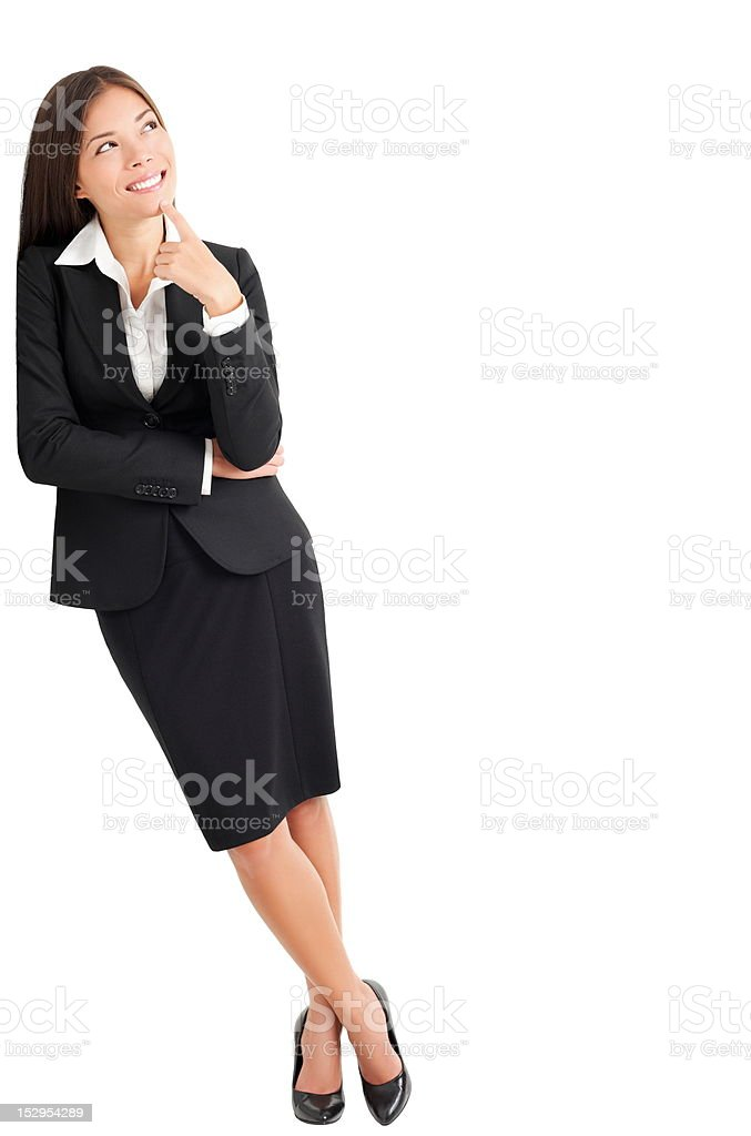 Business woman thinking leaning on wall stock photo