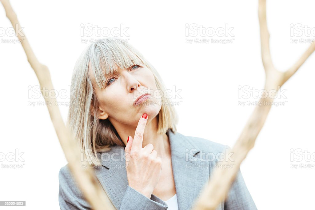 Business woman thinking of branching out stock photo