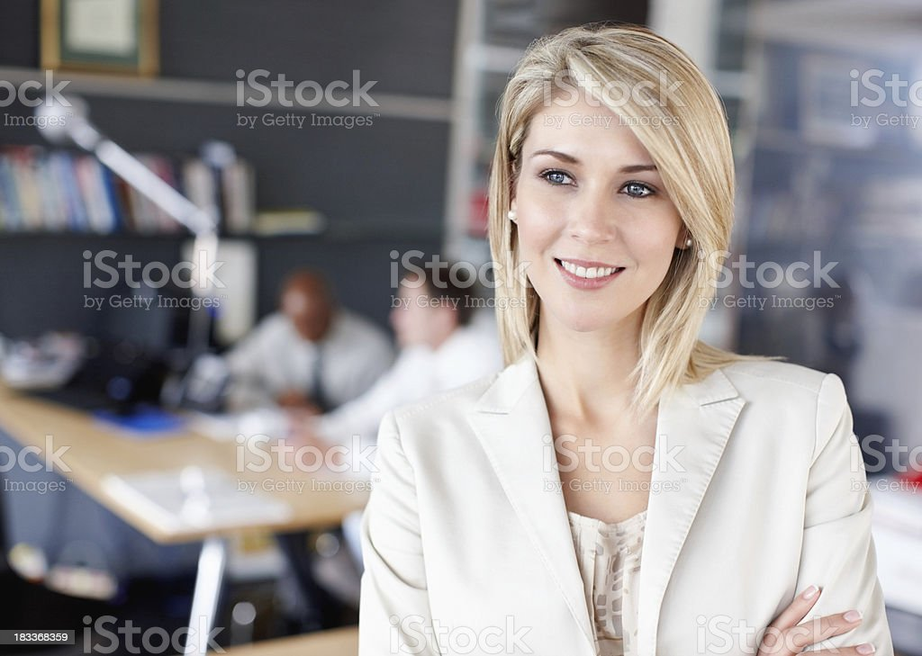 Business woman thinking with colleagues in background royalty-free stock photo